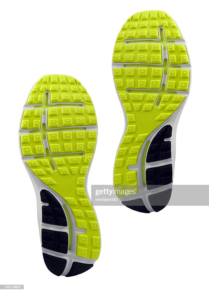 Yellow and black treaded soles of athletic shoes : Stock Photo