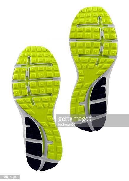 Yellow and black treaded soles of athletic shoes