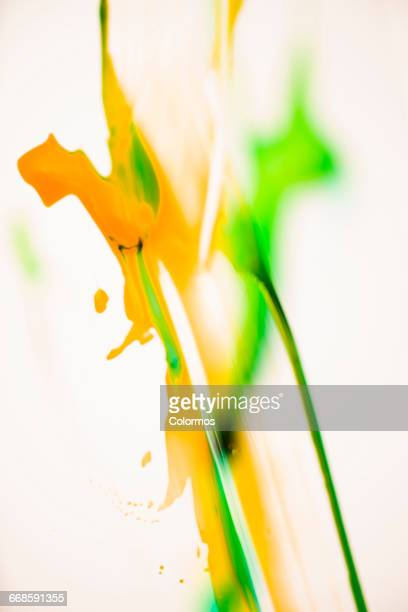 Yellow and green brush stroke on white background