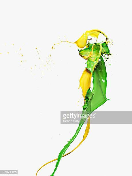 Yellow and green paint colliding