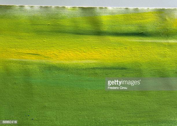 Yellow and green paint on paper, full frame