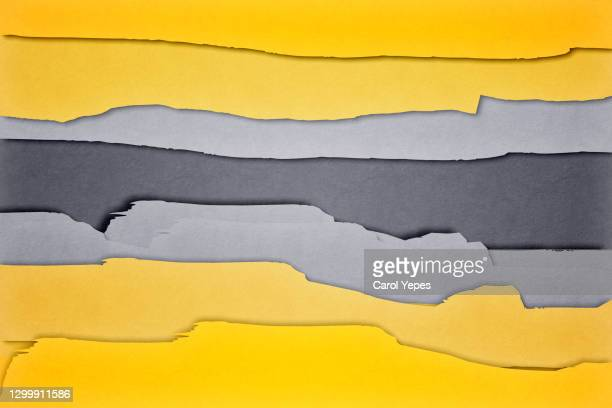 yellow and grey torn paper background - torn stock pictures, royalty-free photos & images