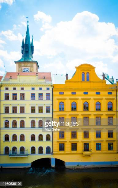 yellow and orange building in prague czech - vltava river stock pictures, royalty-free photos & images
