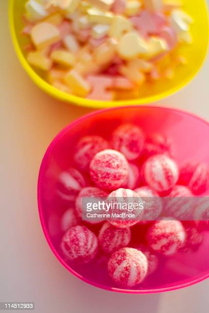 yellow and pink bowl filled with sweets - catherine macbride stock pictures, royalty-free photos & images