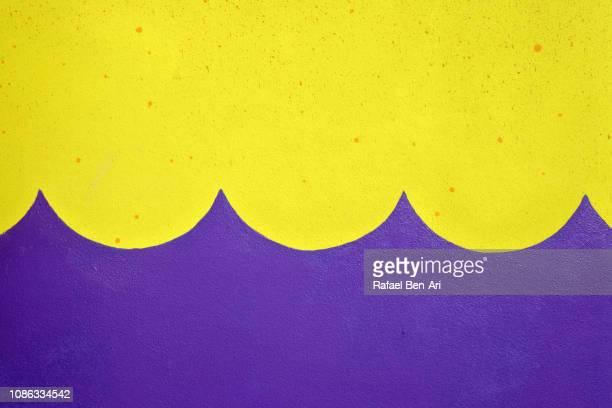 yellow and purple background in the shape of ocean waves - rafael ben ari stock-fotos und bilder