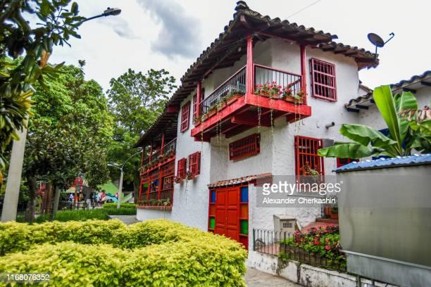 yellow and red building in cultural village pueblito paisa in medellin - kolumbien stock-fotos und bilder