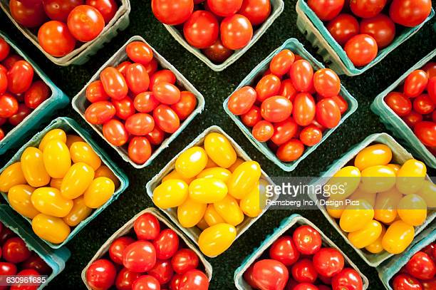 Yellow and red cherry tomatoes in containers