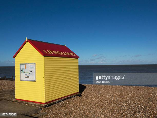 Yellow and red lifeguard hut by the sea on a blue sky day at Whitstable Whitstable is a seaside town located on the north coast of Kent in southeast...