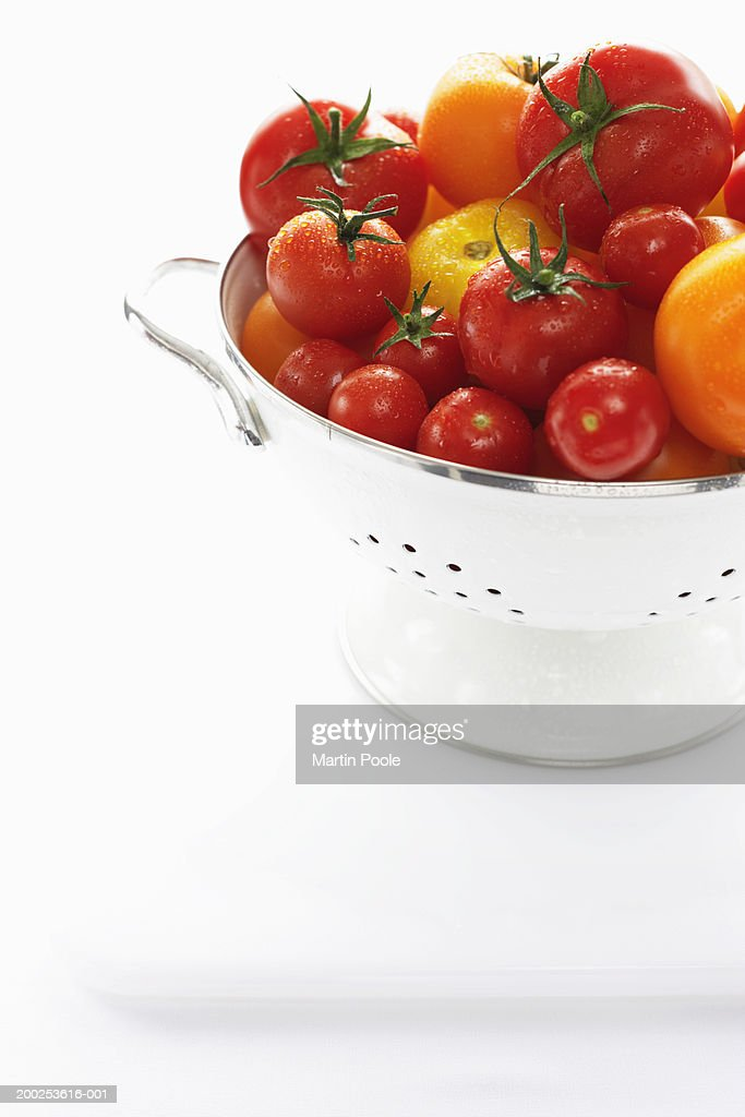 Yellow and red tomatoes in metal strainer : Stock Photo