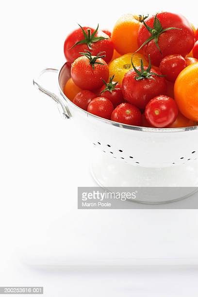 yellow and red tomatoes in metal strainer - colander stock photos and pictures