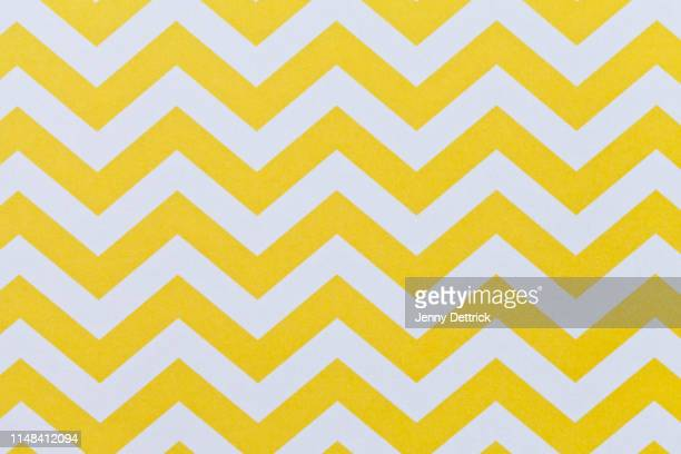 yellow and white chevron pattern - seamless pattern stock pictures, royalty-free photos & images