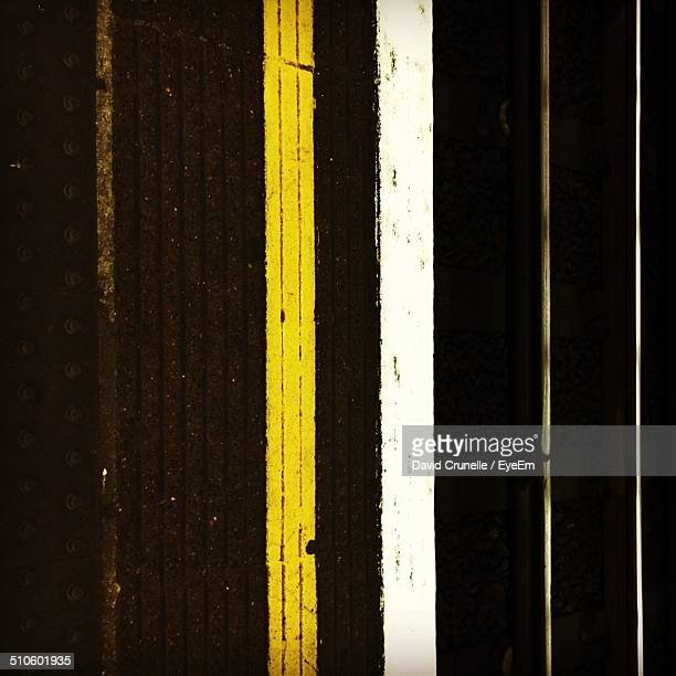 Yellow and white line on railway station platform