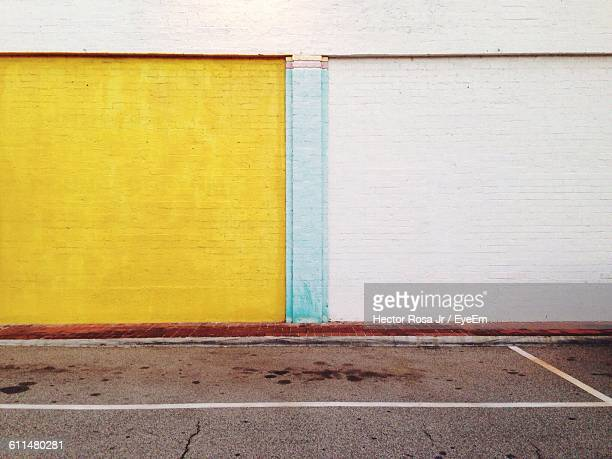 Yellow And White Painted Brick Wall