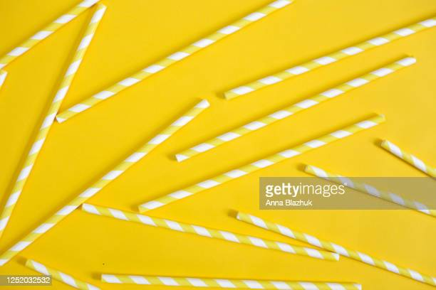 yellow and white striped paper straws. abstract summer background with drinking straws - straw stock pictures, royalty-free photos & images