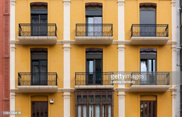 yellow apartment building in spain - castellon de la plana stock photos and pictures