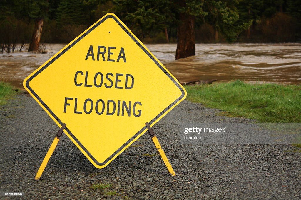 Yellow Area Closed Flooding Sign : Stock Photo
