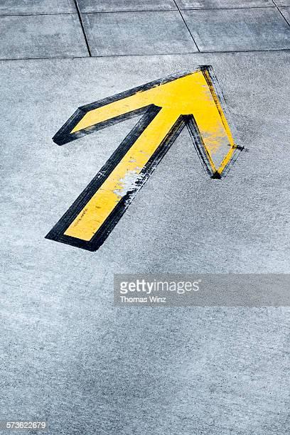 Yellow arrow on driveway