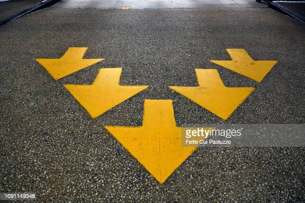yellow arrow sign at downtown houston, texas, usa - arrow stock pictures, royalty-free photos & images