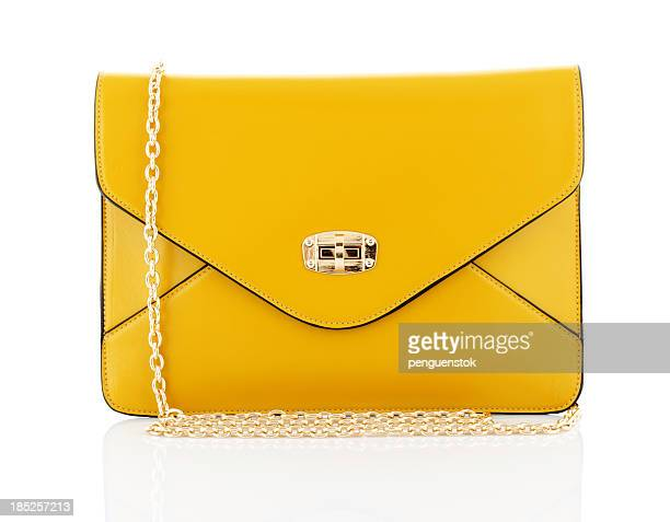 yellow bag - clutch bag stock pictures, royalty-free photos & images