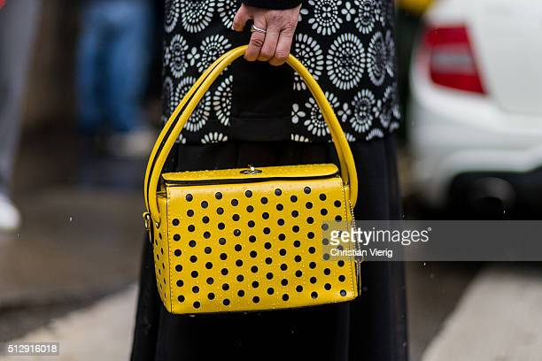 A yellow bag seen outside Dolce Gabbana during Milan Fashion Week Fall/Winter 2016/17 on February 28 in Milan Italy