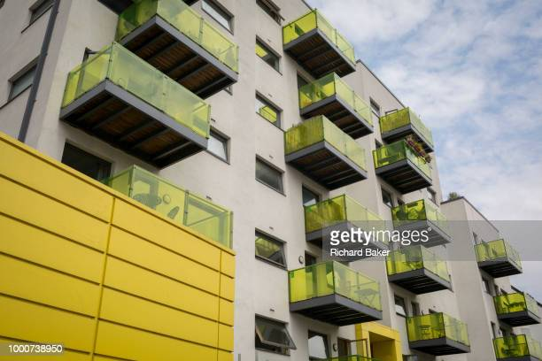 Yellow balconies and fencing of flats along Colharbour Lane in Camberwell on 5th July 2018 in London England