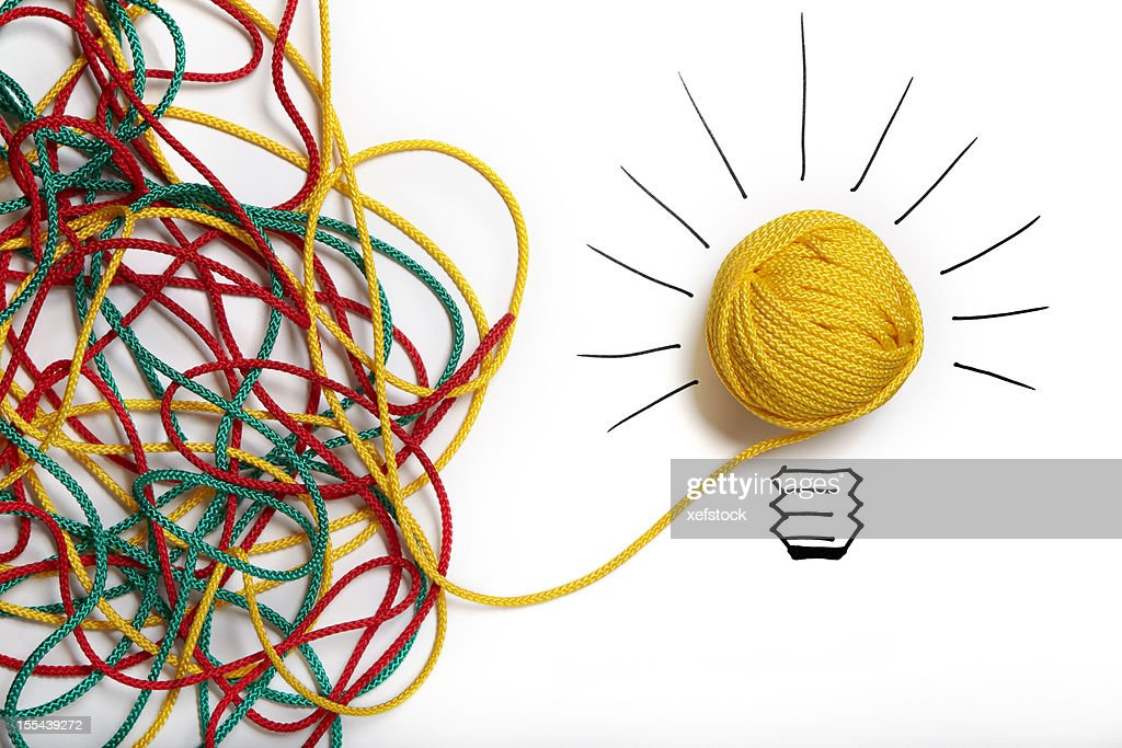 Yellow ball of wool with pen lines like lightbulb : Stock Photo