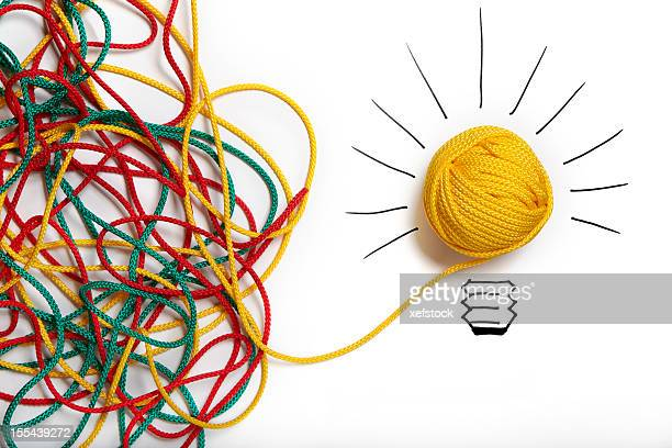 Yellow ball of wool with pen lines like lightbulb