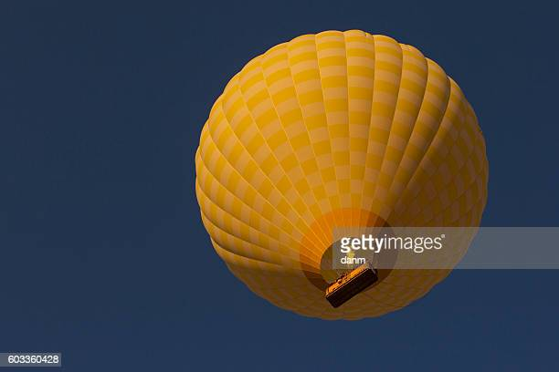 Yellow balloon in the blue sky. Cappadocia, Turkye
