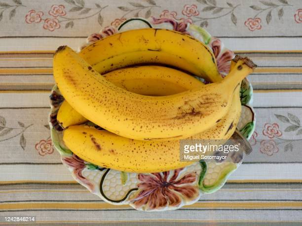 yellow bananas in a fruit bowl - ripe stock pictures, royalty-free photos & images