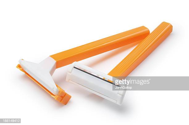 yellow basic pair of razors in white background - razor stock photos and pictures