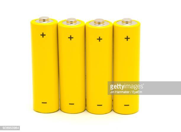 yellow batteries over white background - battery stock photos and pictures