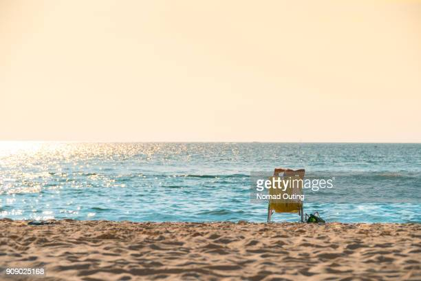 yellow beach chair for relaxation time for sunset scenic and positive emotion therapy. - tumbona fotografías e imágenes de stock
