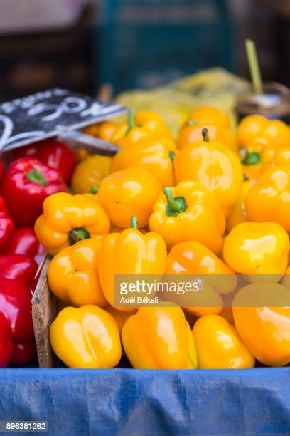 Yellow bell peppers at the market