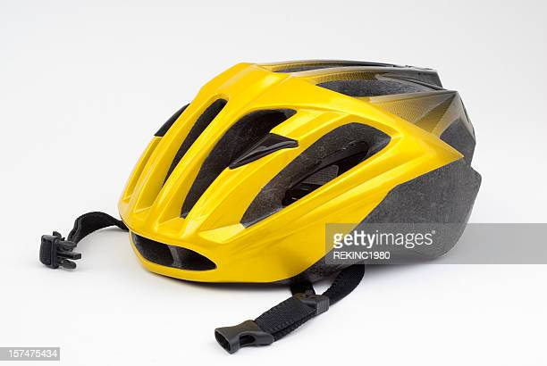 yellow bicycle cycling helmet on white - cycling helmet stock pictures, royalty-free photos & images