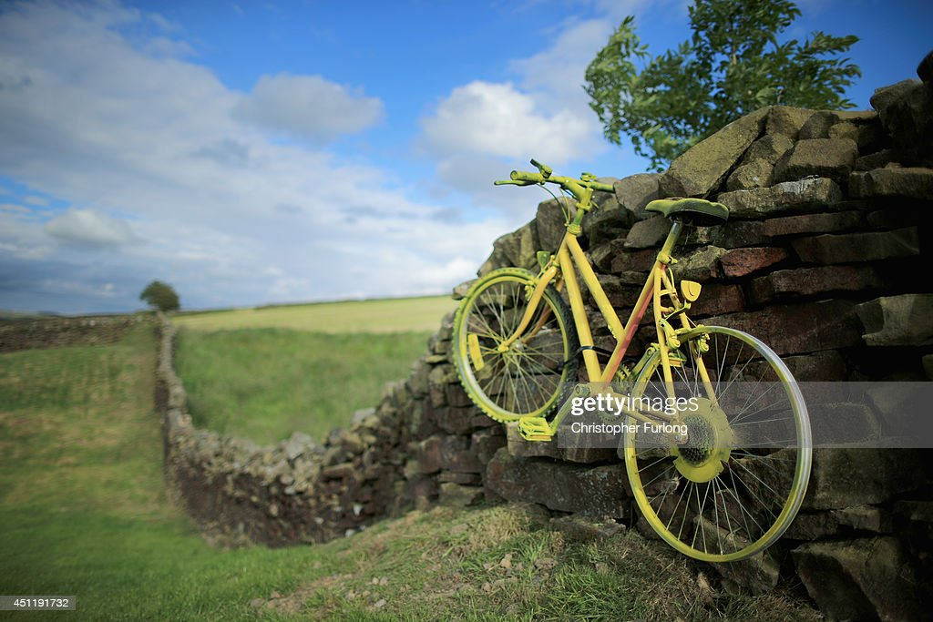 A yellow bicycle hangs from a dry stone wall as Yorkshire prepares to host the Tour de France Grand Depart, on June 24, 2014 in Addingham, United Kingdom. The people of Yorkshire are preparing to give the riders of the 2014 Tour de France a grand welcome as the route of stages one and two are decorated with bunting, bikes and yellow jerseys The Grand Depart of the 2014 Tour De France is taking place in Leeds with the first two stages taking place across Yorkshire on 6th and 7th of July.