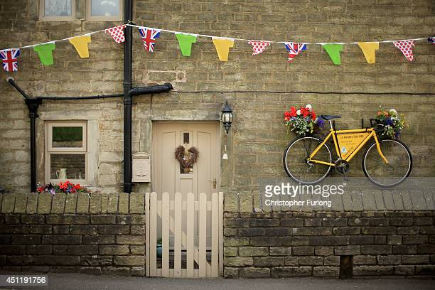 A yellow bicycle hangs from the wall of a stone cottage as Yorkshire prepares to host the Tour de France Grand Depart on June 24 2014 in Holmfirth...
