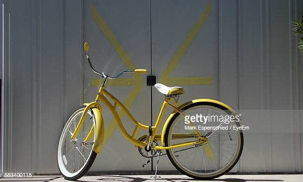 Yellow Bicycle In Front Of Wall