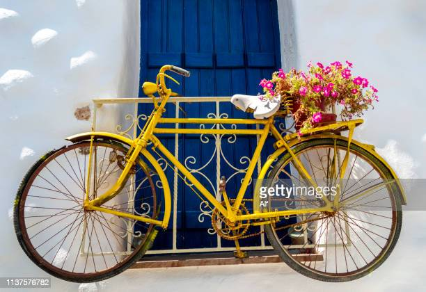 yellow bike in naxos, naxos, cyclades islands, greece - naxos stockfoto's en -beelden
