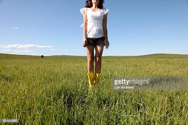 Yellow boots in summer field