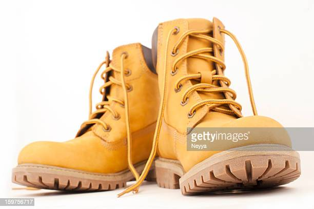 yellow boots - boot stock pictures, royalty-free photos & images