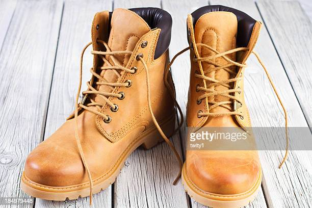 yellow boots - brown boot stock pictures, royalty-free photos & images