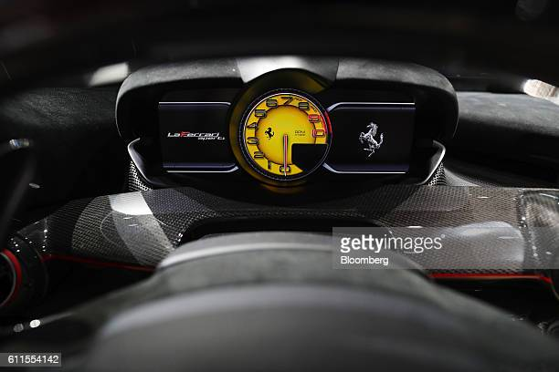 A yellow branded rev counter sits inside the LaFerrari Aperta automobile produced by Ferrari NV during the second press day of the Paris Motor Show...