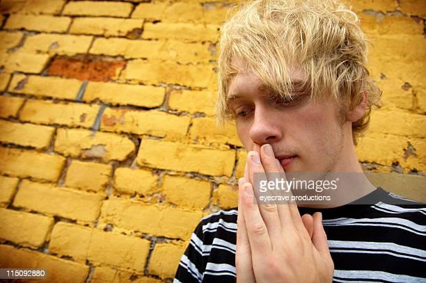 yellow brick wall prayer portraits