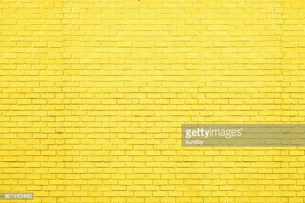 yellow bricks pattern on wall for abstract background. - yellow photos et images de collection
