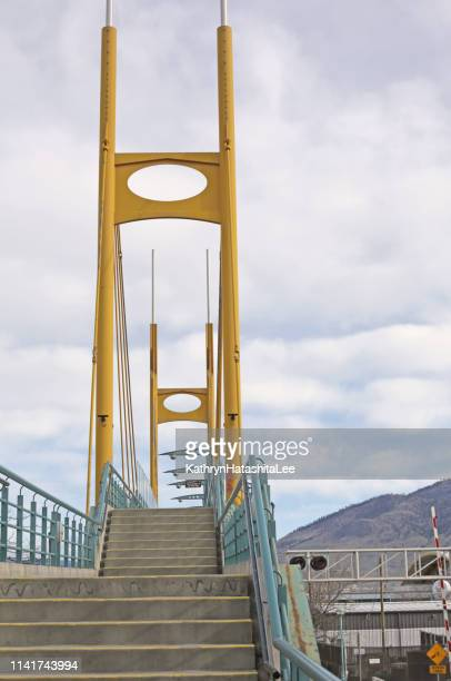 yellow bridge, downtown kamloops, canada - kamloops stock pictures, royalty-free photos & images