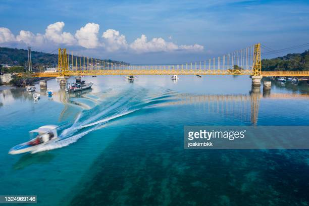yellow bridge in nusa lembongan island in bali indonesia - coral sea stock pictures, royalty-free photos & images