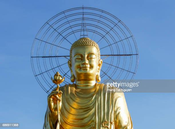 Yellow buddha on blue sky
