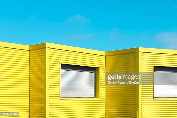 yellow buildings against clear blue sky - loire atlantique stock pictures, royalty-free photos & images