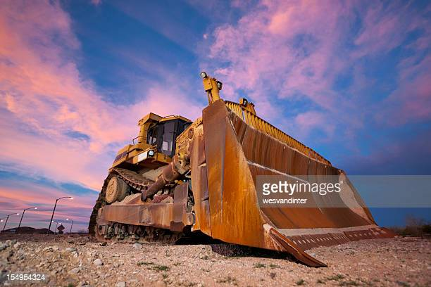 Yellow bulldozer working at Sunset
