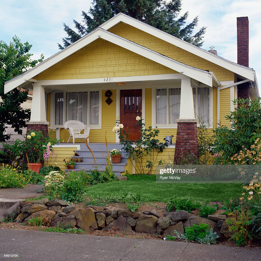 Yellow Bungalow Style House With Garden Exterior View Stock Photo